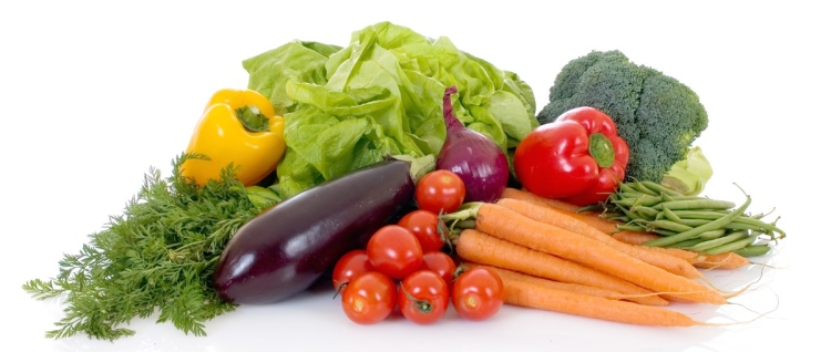 Fresh bio vegetables, white background, reflective surface.jpg